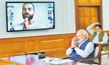 Narendra Modi video Conference with Indian Players - Sakshi