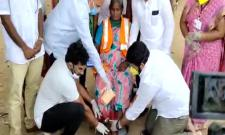 YSRCP MLA Jakkampudi Raja Legs washed to a sanitary worker