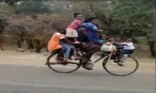 Family Circus On Cycle Funny Viral Video - Sakshi
