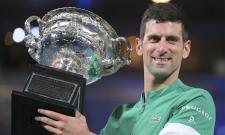 Novak Djokovic Clinches 9th Australian Open Thrashing Danil Medvedev - Sakshi