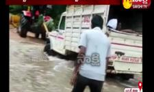 Pregnant Woman Crossing Water Stream At Adilabad District