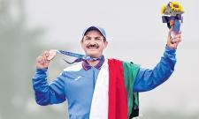 Al-Rashidi gets his Olympic moment with Kuwaiti flag - Sakshi