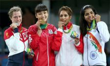 Tokyo Olympics: Why Do Athletes Bite Their Medals - Sakshi