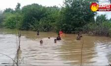 Sisters Washed Away In Flood Water In Yadadri