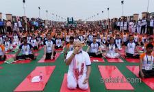 PM Narendra Modi participates in a mass yoga session