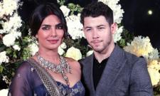 Priyanka Chopra and Nick Jonas pose wedding reception in Mumbai - Sakshi