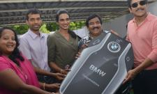 Nagarjuna Gifted BMW Car to PV Sindhu - Sakshi