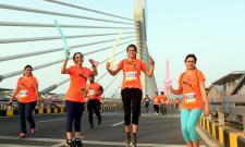 10km and 5km Runs Held at Hyderabad Cable Bridge - Sakshi
