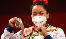 Tokyo Olympics Mirabai Chanu womens 49kg weightlifting event - Sakshi
