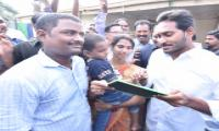 YS Jagan perform Aksharabhyasam for children  - Sakshi