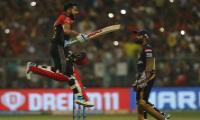 royal challengers won 10 runs kolkata knight riders - Sakshi