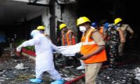 Fire Accident In Swarna Palace Hotel Vijayawada - Sakshi