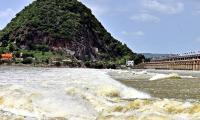 Heavy Flood Water Inflow Continues To Prakasam Barrage Photos - Sakshi