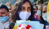 PV Sindhu receives grand welcome at Delhi airport Photo Gallery - Sakshi