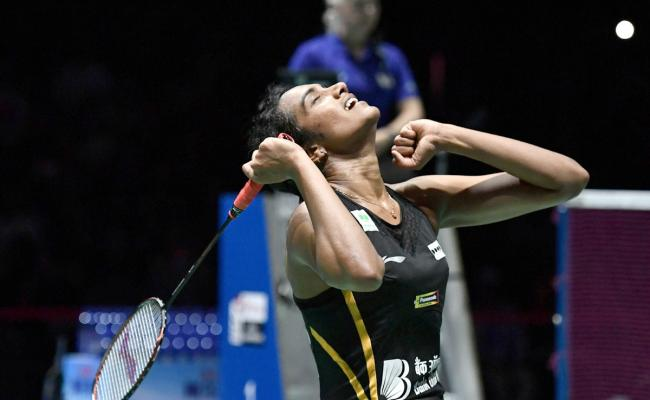 P V Sindhu Becomes First Indian To Clinch Badminton World Championships Gold - Sakshi