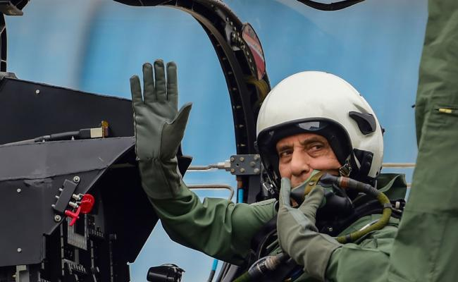 Rajnath Singh becomes fly in light combat aircraft Tejas Photo Gallery - Sakshi