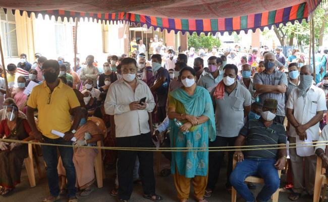 people Ttaking Corona Vaccine And Corona Test Photo Gallery - Sakshi