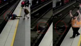 commuters rush to save Faint Man collapse on Railway Track