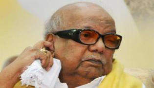 Karunanidhi  kissing his great grandson