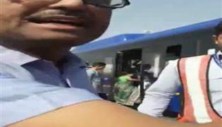 IndiGo staff manhandle a passenger at Delhi's Indira Gandhi International Airport - Sakshi