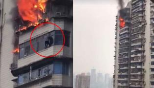 China Man Hangs From Building To Escape Fire - Sakshi