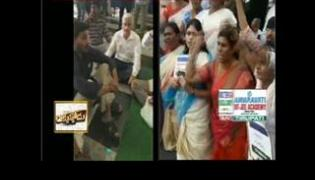 AP Special Status || people protest with candles in front of airport - Sakshi
