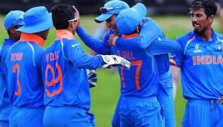 India beat Australia to lift World Cup - Sakshi