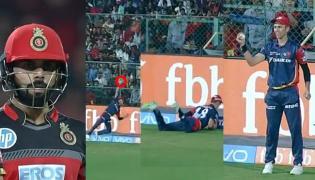 Trent Boult Kohli Catch in IPL a LifeTime - Sakshi