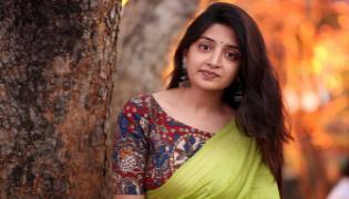 Poonam Kaur Target Director on Her Twitter - Sakshi