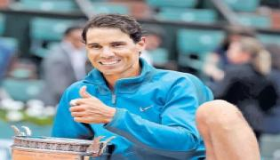 Rafael Nadal claims record extending 11th French Open title  - Sakshi