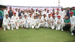 Indian Team Invites Afghanistan To Pose With The Trophy . - Sakshi