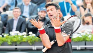 Marco Cecchinato shocks Novak Djokovic in French Open - Sakshi