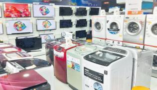 GST on refrigerators, washing machine reduced to 18 percent - Sakshi