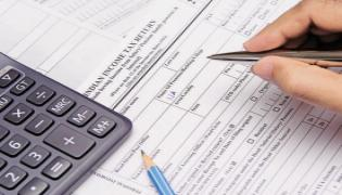 Govt extends deadline for filing income tax returns by a month to August 31 - Sakshi