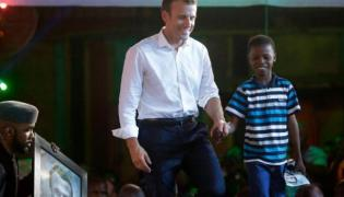 The 11-year-old Nigerian artist who moved President Macron - Sakshi