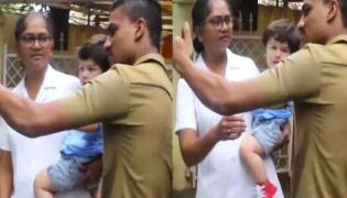 A man forcibly tries to take a selfie with Taimur Ali Khan video goes viral - Sakshi