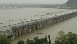 Prakasam Barrage  opens its gates as massive inflows fill barrage - Sakshi
