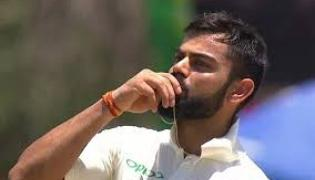Virat Kohli kisses his wedding ring as he dedicates his ton to Anushka - Sakshi