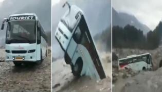 Vacant Bus Washed Away Flooded Beas River In Manali - Sakshi