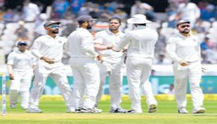 West Indies 295/7 at stumps against India - Sakshi