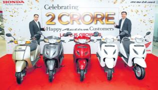 Honda Activa crosses 2 crore volume mark - Sakshi
