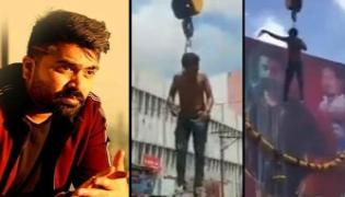 Watch- Simbu Fan Hangs From Crane - Sakshi