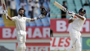 India vs West Indies, LIVE Score, First Test Day 2 at Rajkot: Kohli - Sakshi