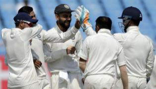 India Outclass Windies To Register Big Win In Rajkot Test - Sakshi