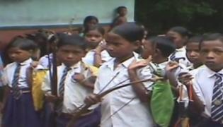 Childrens Carry Bow And Arrows To School To Protect Themselves From Naxals - Sakshi