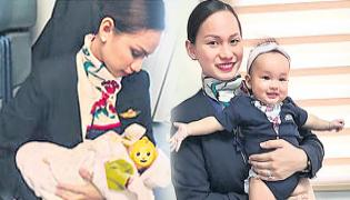 Passenger runs out of formula milk, flight attendant breastfeeds her baby - Sakshi