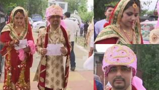 Newly married couple cast vote in Udhampur - Sakshi