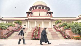 Again to Supreme Court For Division of power employees - Sakshi