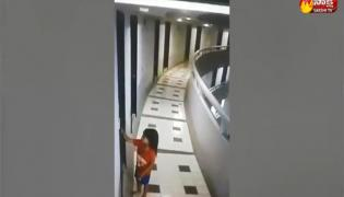 Child Falls From 11th Floor Balcony, Survives - Sakshi