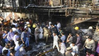 Surat Fire Accident Class 10 Girl Saved in Massive Fire Says Did Not Panic - Sakshi